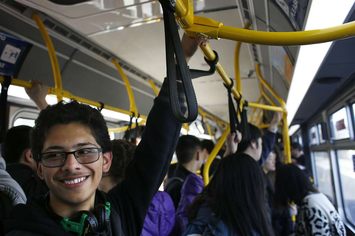 Lowell High School student Mario Ortega, 17, smiles as Muni operator Charles Davis sings out a stop on the 29 Sunset in San Francisco, Calif.