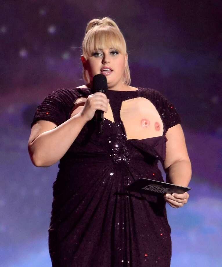 Nip slips require a serious drink Wait, did you just see that? Down your drink to the last sip for every nip slip. (Thanks, Rebel Wilson, for the double-nipple pic.)  Photo: Kevin Mazur, WireImage