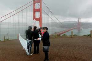 The wind was too much for Gee Olivar's umbrella during her visit to the Marin Headlands in February 2014.