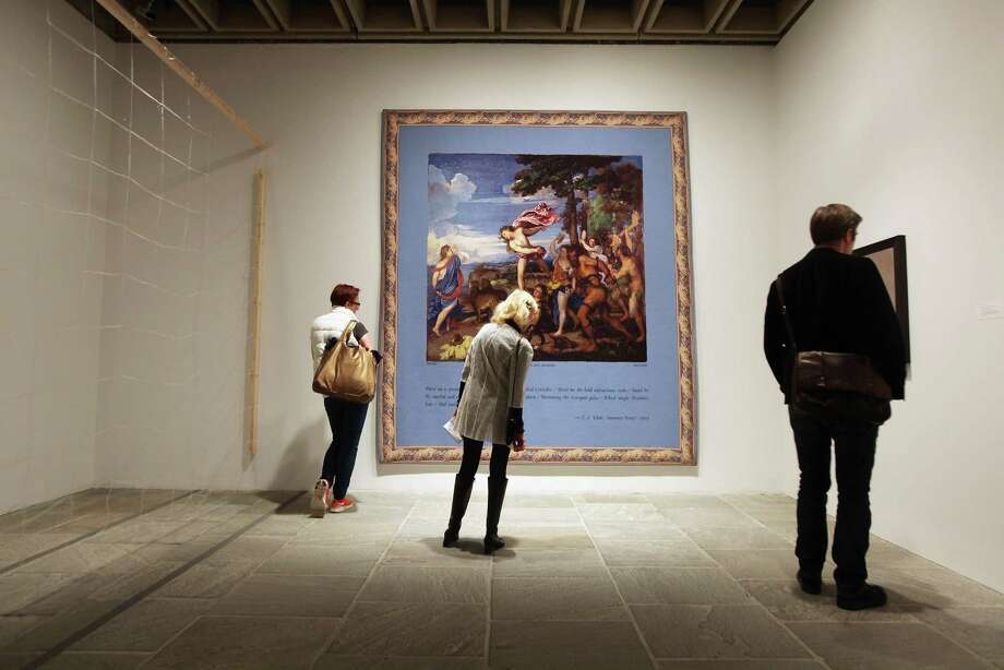 """Visitors view Elaine Reichek's """"Paint Me a Cavernous Waste Shore"""" in 2012 at the Whitney Museum of American Art in New York. This year's biennial will encompass three floors by three curators. Photo: Mario Tama, Staff / 2012 Getty Images"""