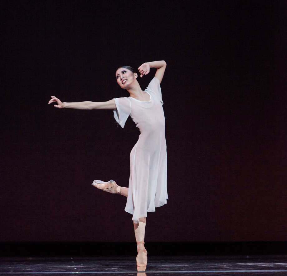 "Houston Ballet demi-soloist Nozomi Iijima in a scene from Stanton Welch's ""Blessed Memory."" Photo: Amitava Sarkar / ONLINE_YES"
