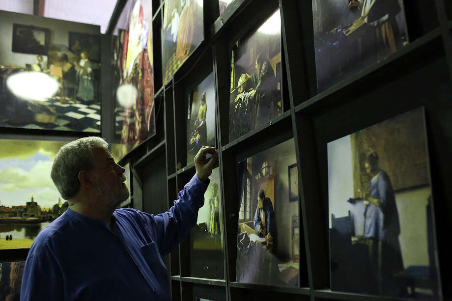 "Tim Jenison, who used optical devices and mirrors to paint Vermeer's ""The Music Lesson,"" talks about the process amid posters of paintings by Johannes Vermeer at his studio in San Antonio on Thursday, Feb. 20, 2014. Photo: Lisa Krantz / San Antonio Express-News"