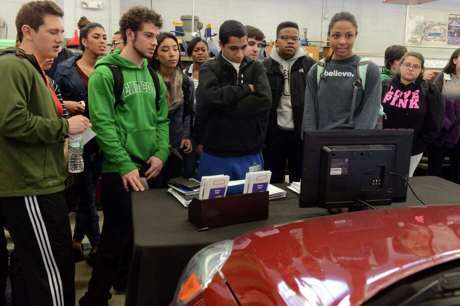 Bunnell students watch a monitor that shows the movements of one of their classmates using a driving simulator to test the difference between driving and driving while texting Friday, Feb. 28, 2014, in the auto shop at Bunnell High School in Stratford, Conn. Photo: Autumn Driscoll / Connecticut Post