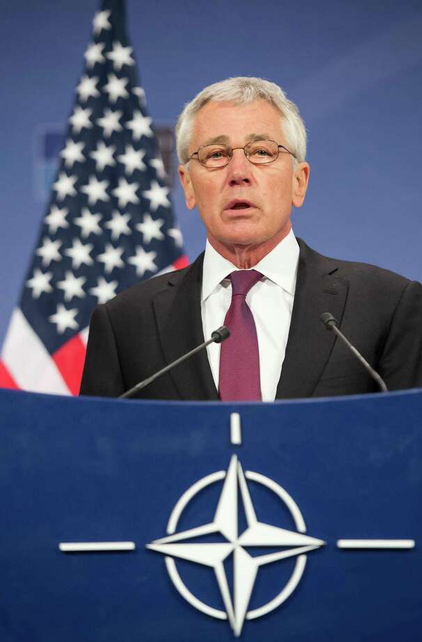 A reader disagrees with the proposals made by Secretary of Defense Chuck Hagel, shown here after a recent meeting of NATO defense ministers in Brussels, to downsize the military. Photo: Geert Vanden Wijngaert / Associated Press / AP