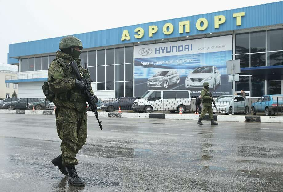 Soldiers, who declined to say whether they were Russian or Ukrainian, patrol the airport in the city of Simferopol. Photo: Sean Gallup, Getty Images