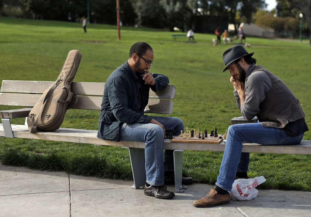Robin Mugnaini, right, and Julian Davis, left, play a game of chess in Dolores Park in San Francisco, Calif., on Thursday, February 27, 2014. Dolores Park, one of the most popular spots in the city, is closing Saturday for more than a year of rehab work and upgrades.