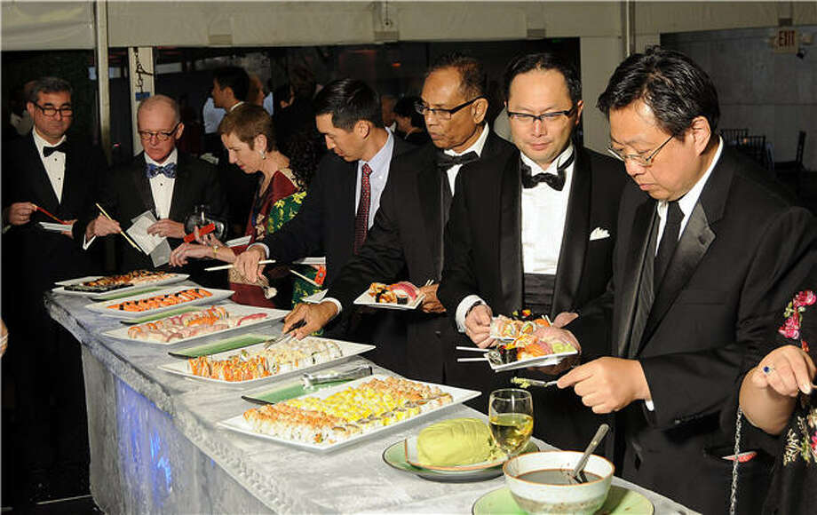 Tiger Ball guests enjoying the sushi bar. Photo: Dave Rossman, For The Chronicle