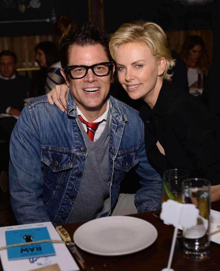 "Johnny Knoxville and Charlize Theron attend Bionic Yarn, G-Star and Hennessy Privilege Celebrate Pharrell Williams and his Oscar nominated single, ""Happy"" on February 27, 2014 in Los Angeles, California. Photo: Dimitrios Kambouris, Getty Images For One View"