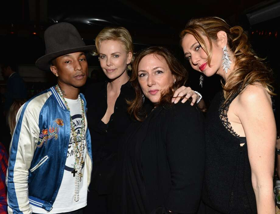 "Designers Lorraine Schwartz and Ofira Sandberg pose with Pharrell Williams and Charlize Theron at Bionic Yarn, G-Star and Hennessy Privilege Celebrate Pharrell Williams and his Oscar nominated single, ""Happy"" on February 27, 2014 in Los Angeles, California. Photo: Dimitrios Kambouris, Getty Images For One View"