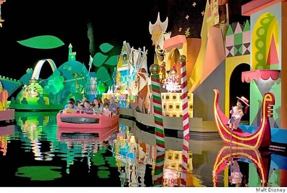A boat winds through Disney World's It's a Small World ride, which features artwork designed by Mary Blair. The ride's theme song tends to stick in your head, either making you smile or driving you crazy. Photo: Disney