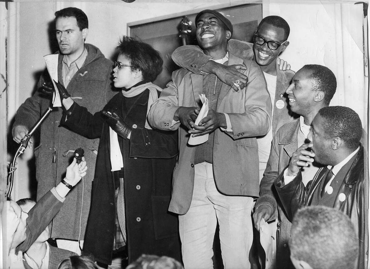 Protest leaders make an announcement (l-r) Mike Myerson, Tracy Sims, Roy Ballard, Dick Gregory. The Sheraton Palace hotel sit in and protest claimed discriminatory hiring practices. Photo ran Sunday March 8, 1964, Page A1