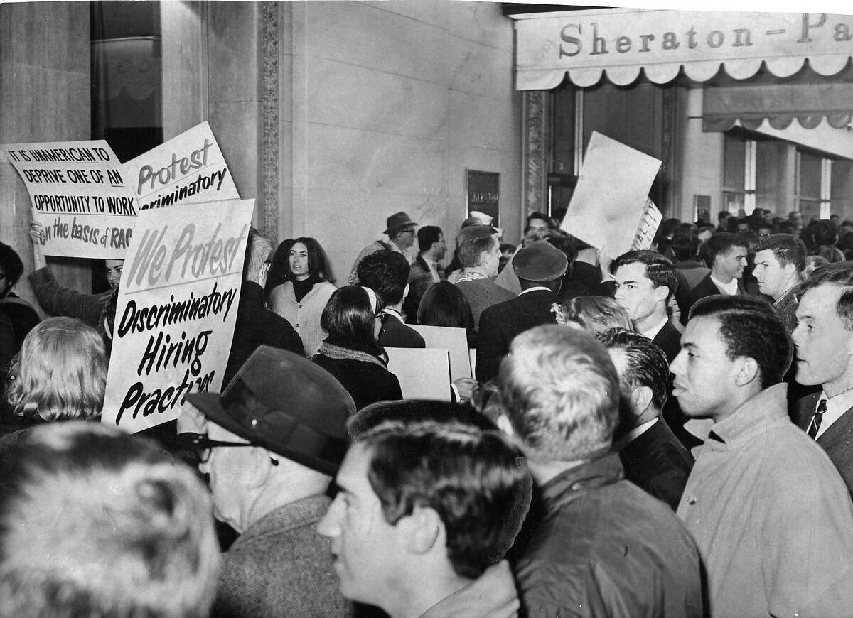 Civil rights demonstrators outside of the Sheraton Palace hotel. The sit in and protest claimed discriminatory hiring practices. Photo ran March 7, 1964, Page 7 No photographer identified.