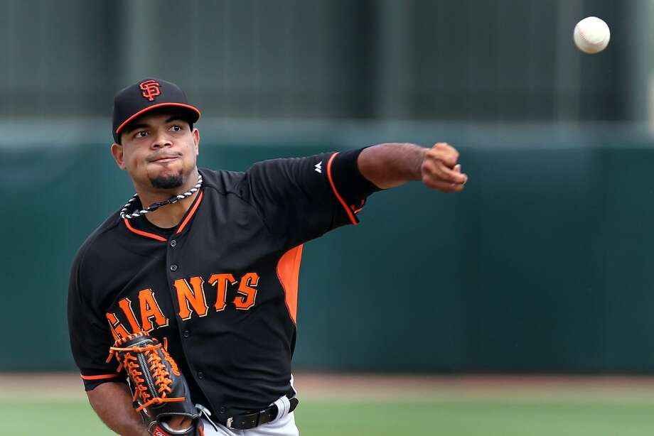 Giants left-hander Edwin Escobar pitches during a six-up, six-down start against the A's. Photo: Lance Iversen, Reuters