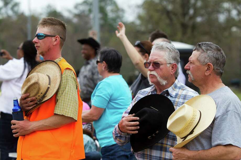 Warren Kelly, left, Bubba Morrison and Phillip Gates pay their respect to Robert Joe, a Northeastern Trail Ride founding member who passed away yesterday. Friday, Feb. 28, 2014, in Houston. Photo: Marie D. De Jesús, Houston Chronicle / © 2014 Houston Chronicle