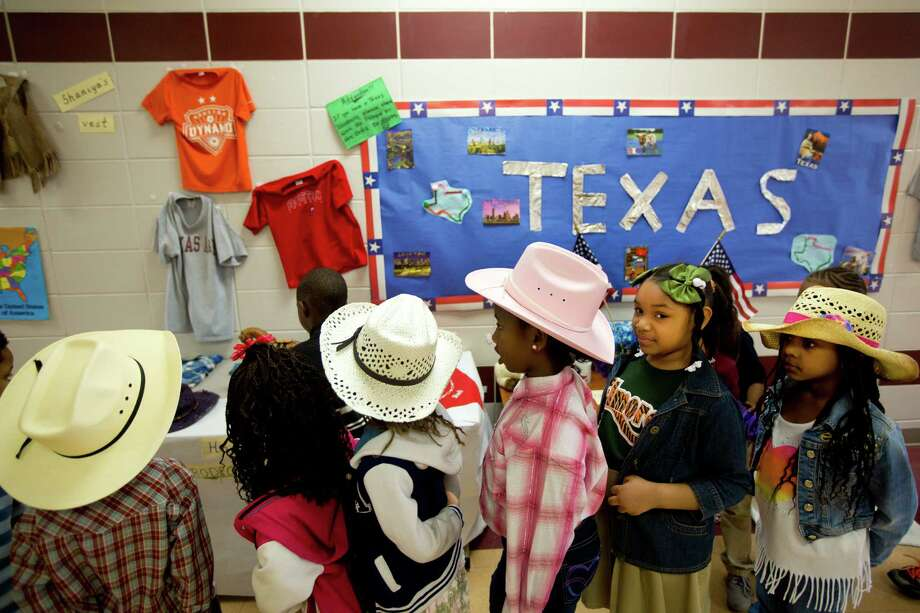 B.C Elmore Elementary School students pass by a Texan pride display on the hallways of their school. Friday, Feb. 28, 2014, in Houston. Photo: Marie D. De Jesús, Houston Chronicle / © 2014 Houston Chronicle