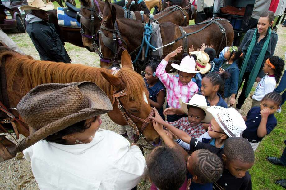 Northeastern Trail Rider Angela Reynolds shows her horse to B.C Elmore Elementary School kindergarten students during one of their break stops on their way to Memorial Park, Friday, Feb. 28, 2014, in Houston. Photo: Marie D. De Jesús, Houston Chronicle / © 2014 Houston Chronicle