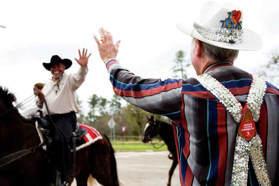 A rodeo clown waves to one of the Northeastern Trail Riders as they arrive to Memorial Park, Friday, Feb. 28, 2014, in Houston. Photo: Marie D. De Jesús, Houston Chronicle / © 2014 Houston Chronicle