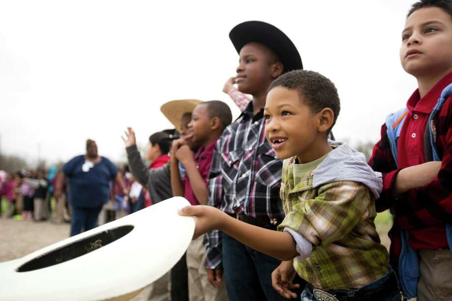 Damecko Williams, 7, welcomes with his cowboy hat the Northeastern Trail Riders, Friday, Feb. 28, 2014 to his school B.C Elmore Elementary School in Houston. Photo: Marie D. De Jesús, Houston Chronicle / © 2014 Houston Chronicle