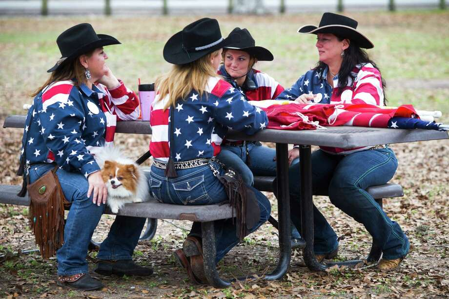 Shelley Aronone, Noelle Hirst, Kendra Cox, Melanie Benny rock their patriotic shirts in Memorial Park right after their arrival to the park, Friday, Feb. 28, 2014, in Houston. The ladies are members of the Texas Independence Trail Riders. Photo: Marie D. De Jesús, Houston Chronicle / © 2014 Houston Chronicle