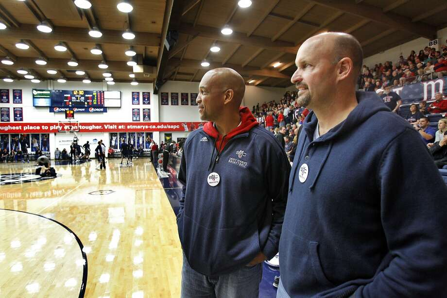 Greg Holt (left) and Brad Levesque watch their sons Stephen and Beau, respectively, warm up for a game against BYU. Photo: Carlos Avila Gonzalez, The Chronicle