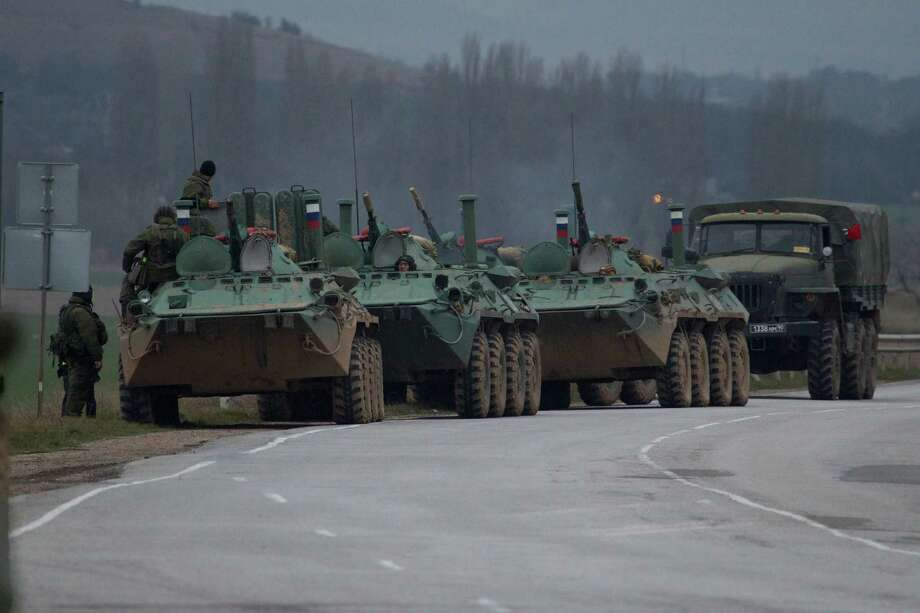 Russian armored personnel carriers and a truck are parked on the side of the road near the town of Bakhchisarai, Ukraine, Friday, Feb. 28, 2014. The vehicles were parked on the side of the road near the town of Bakhchisarai, apparently because one of them had mechanical problems. Photo: Ivan Sekretarev, AP / AP