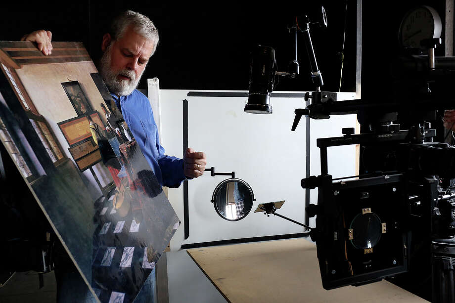 "Tim Jenison, who used optical devices and mirrors to paint Vermeer's ""The Music Lesson,"" talks about the process at his studio in San Antonio on Thursday, Feb. 20, 2014. Photo: Lisa Krantz / San Antonio Express-News"