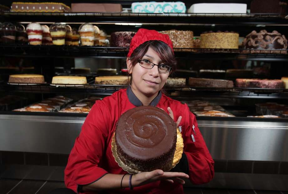 Cake Specialist Jael Sanchez poses for a portrait with a Chocolate Ripple Fudge cake at Three Brothers Bakery newest location on Washington Avenue Wednesday, Feb. 26, 2014, in Houston. ( James Nielsen / Houston Chronicle ) Photo: James Nielsen, Houston Chronicle