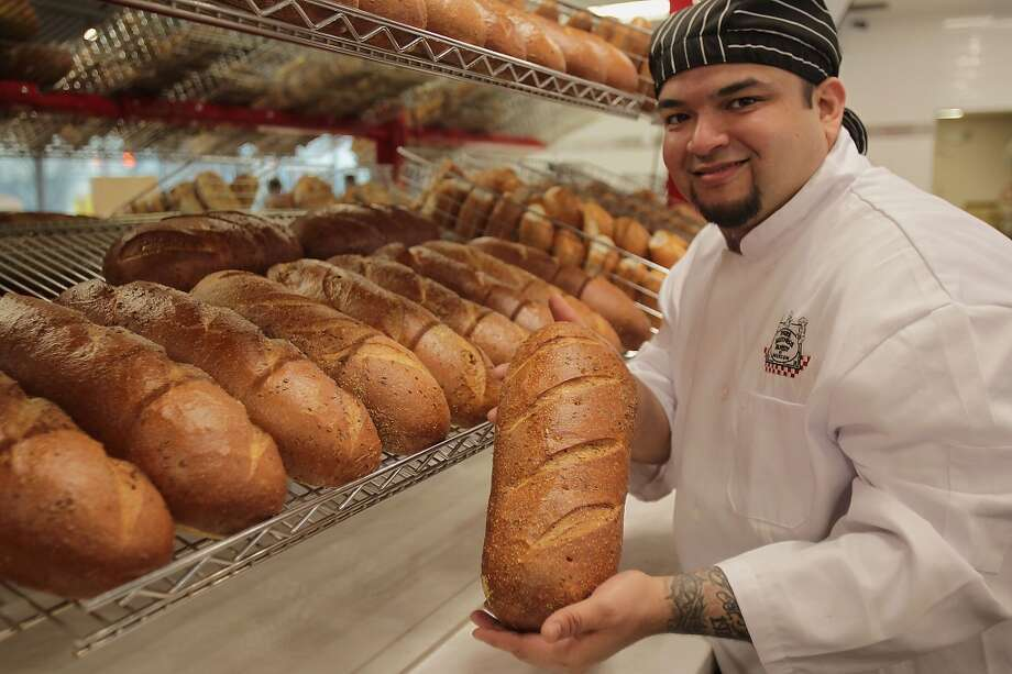 Production Manager Julius Rodriguez poses for a portrait with the rye bread at Three Brothers Bakery newest location on Washington Avenue Wednesday, Feb. 26, 2014, in Houston. ( James Nielsen / Houston Chronicle ) Photo: James Nielsen, Houston Chronicle