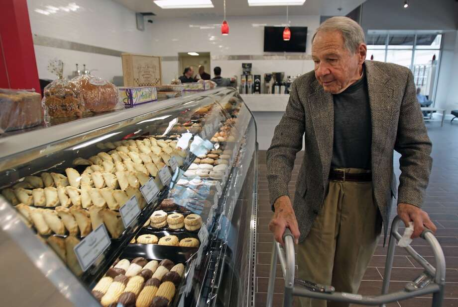 Sigmund Jucker, one of the founding three brothers of Three Brothers Bakery looks over the display case at Three Brothers Bakery newest location on Washington Avenue Wednesday, Feb. 26, 2014, in Houston. ( James Nielsen / Houston Chronicle ) Photo: James Nielsen, Houston Chronicle
