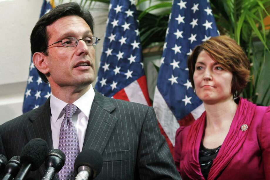 FILE - In this May 3, 2011 file photo, House Majority Leader Eric Cantor of Va., accompanied by Rep. Cathy McMorris Rodgers, R-Wash., speaks to reporters on Capitol Hill in Washington. House Republican leaders took a small step on Friday toward pulling together a viable alternative to President Barack Obama's four-year-old health care law. On Friday, Cantor met privately with Rodgers, the vice chairman of the Republican Conference and three Republican committee chairmen _ Budget's Paul Ryan of Wisconsin, Education's John Kline, of Minnesota, and Ways and Means' Dave Camp of Michigan to discuss a way forward. (AP Photo/Jacquelyn Martin, File) Photo: Jacquelyn Martin, STF / AP