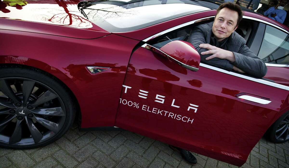 """Elon Musk, co-founder and CEO of Tesla Motors, says the company is doing well now but it had come within """"a few days"""" of bankruptcy at the end of 2008."""