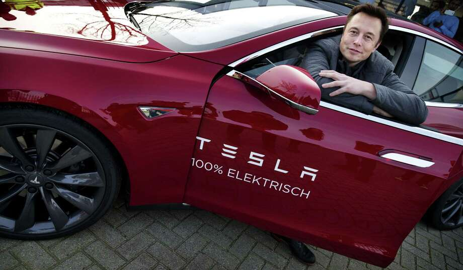 "Elon Musk, co-founder and CEO of Tesla Motors, says the company is doing well now but it had come within ""a few days"" of bankruptcy at the end of 2008. Photo: JERRY LAMPEN, Staff / AFP"