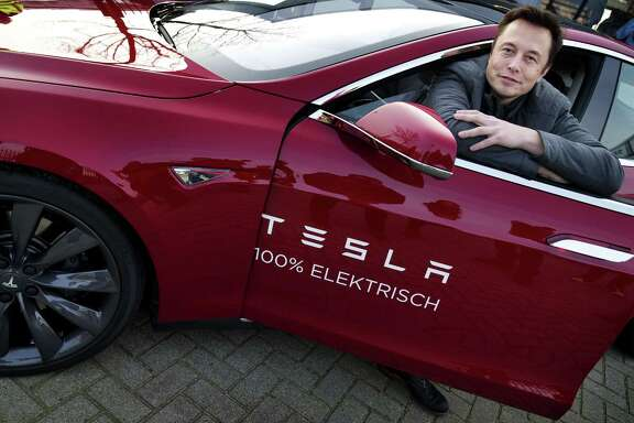 "Elon Musk, co-founder and CEO of Tesla Motors, says the company is doing well now but it had come within ""a few days"" of bankruptcy at the end of 2008."