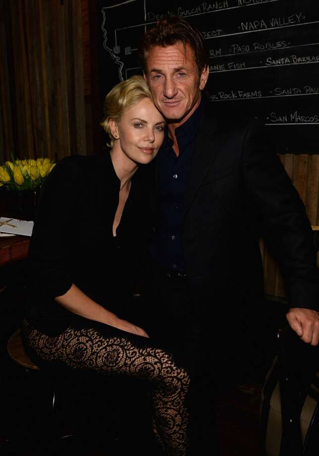 "Charlize Theron and Sean Penn attend Bionic Yarn, G-Star and Hennessy Privilege Celebrate Pharrell Williams and his Oscar nominated single, ""Happy"" on February 27, 2014 in Los Angeles, California. Photo: Getty Images For One View"