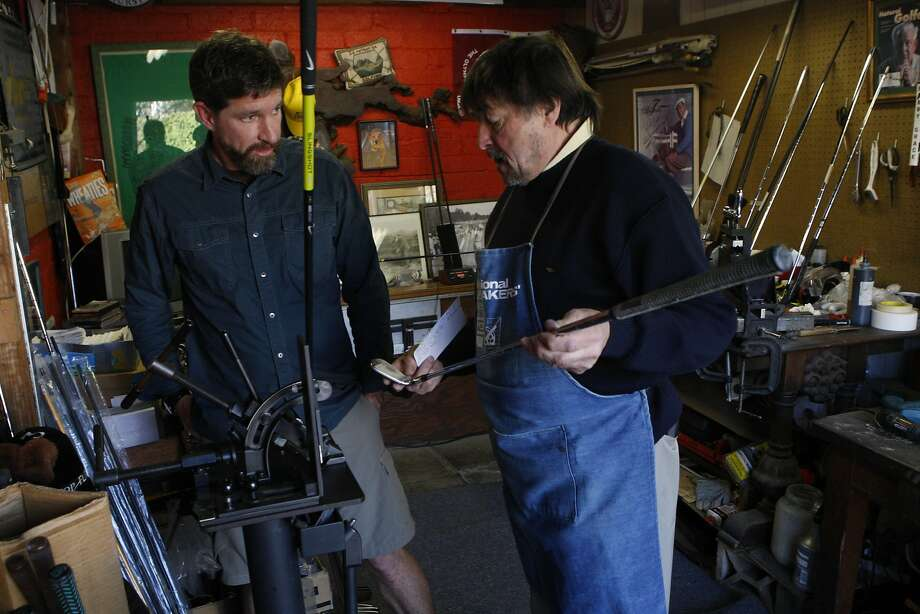 Geoffrey Nelson (left) visits Michael Lee Clark to check on the loft and lie of his club at Clark's garage shop in Berkeley. Photo: Liz Hafalia, The Chronicle