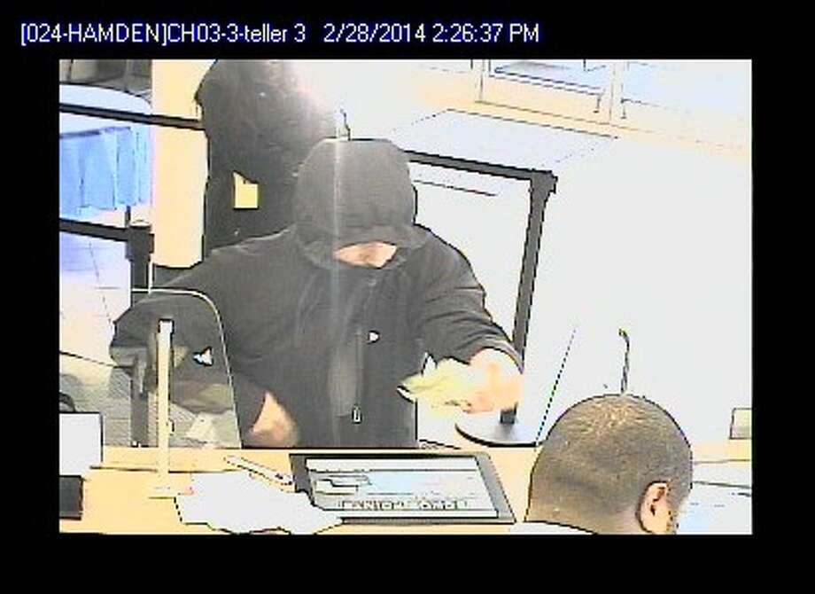 Police in Hamden released this image of an alleged robber who held up the Webster Bank on Helen Street on Feb. 28, 2014 Photo: Contributed Photo