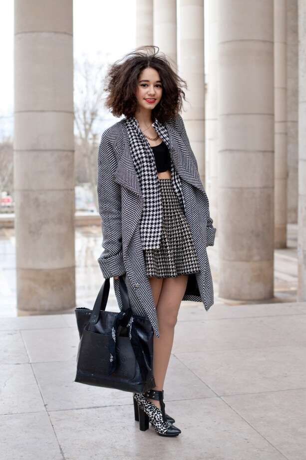 Fashion blogger Lena Mahfouf wears a Front Row skirt, Marc Jacobs bag, Forever 21 shoes, vintage coat and jacket  on February 25, 2014 in Paris, France.  (Photo by Kirstin Sinclair/Getty Images) Photo: Kirstin Sinclair, Getty Images