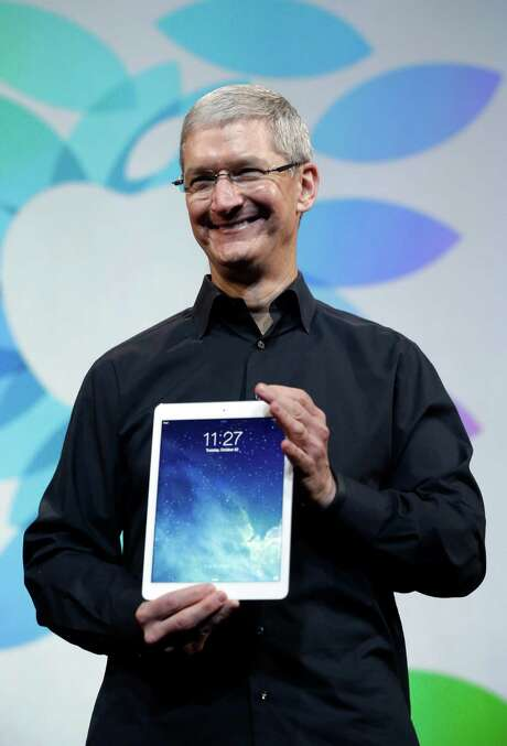 Apple CEO Tim Cook introduces the new iPad Air on Tuesday, Oct. 22, 2013, in San Francisco. (AP Photo/Marcio Jose Sanchez) Photo: Marcio Jose Sanchez, STF / AP