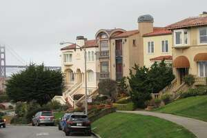 The house at 555 El Camino del Mar (center) is a change in tone for the sedate Seacliff neighborhood -- an idiosyncratic makeover of a 1920s structure, complete with custom railings and a glassy theatrical corner bay. The architect is James G. Stavoy
