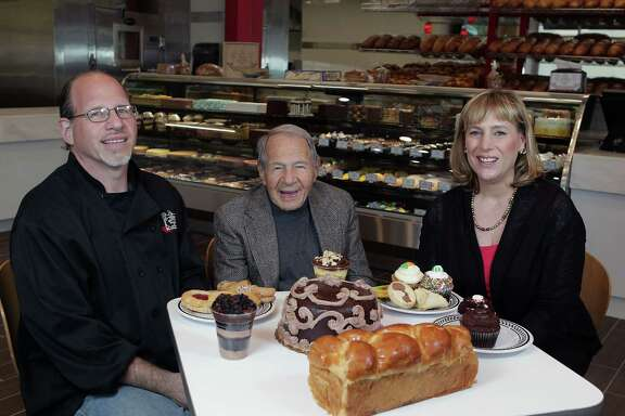 Sigmund Jucker, center, helped found Three Brothers Bakery, now run by Bobby Jucker left, and his wife, Janice Jucker.