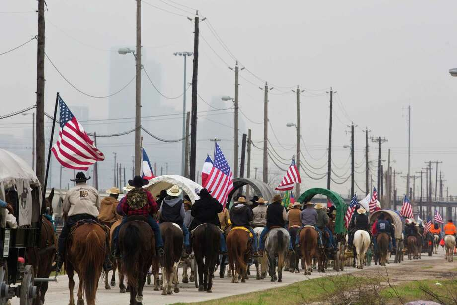 The Northeastern Trail Riders travel on Liberty Road on their way to Memorial Park. Friday, Feb. 28, 2014, in Houston. Photo: Marie D. De Jesús, Houston Chronicle / © 2014 Houston Chronicle