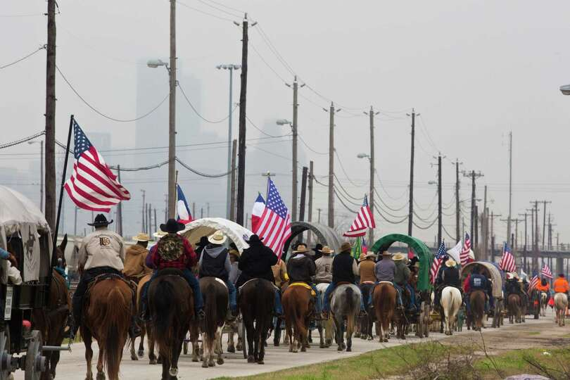 The Northeastern Trail Riders travel on Liberty Road on their way to Memorial Park. Friday, Feb. 28,