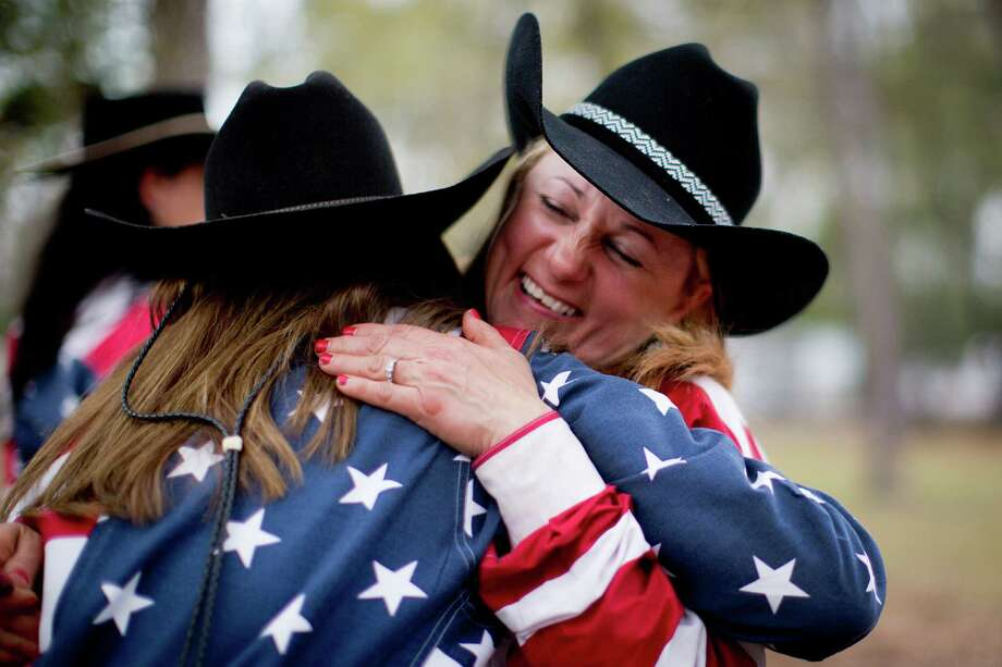 Noelle Hirst, right, embraces Tina Wargo right after arriving to Memorial Park, Friday, Feb. 28, 2014, in Houston. Hirst and Wargo are both members of the Texas Independence Trail Riders. Photo: Marie D. De Jesús, Houston Chronicle / © 2014 Houston Chronicle