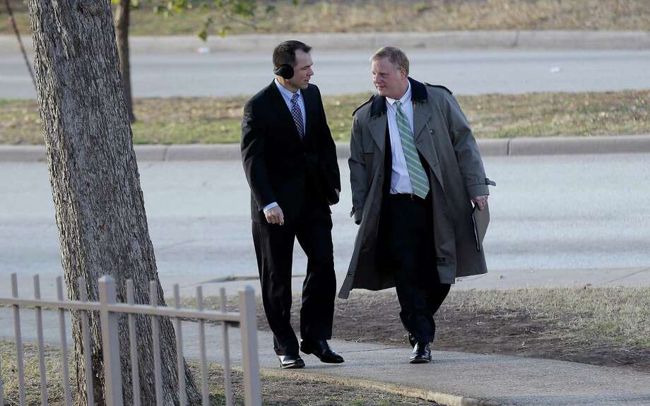 File - In the Feb. 12, 2014 file photo, Victor Holmes, left, and partner Mark Phariss, right, arrive at the U.S. Federal Courthouse, in San Antonio, where a federal judge is expected to hear arguments in a lawsuit challenging Texas' ban on same-sex marriage. Republican attorneys general across the U.S. are fighting court rebukes of same-sex marriage bans in their states. But Texas' Greg Abbott is doing so against extraordinary personal ties: Phariss, one of the gay men challenging the law here is an old friend. (AP Photo/Eric Gay, File) Photo: Eric Gay, STF / AP