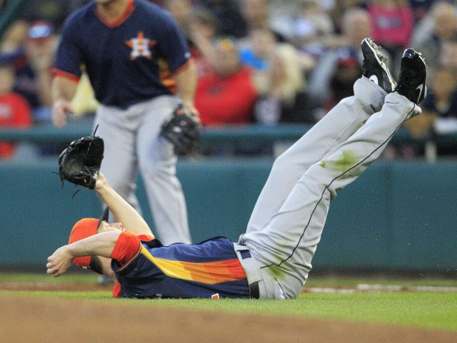 Astros RHP Lucas Harrell lays on his back after reaching for a ball sharply hit by Atlanta's Tommy LaStella. Photo: Karen Warren, Houston Chronicle