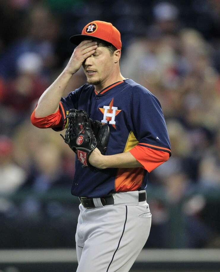 Astros RHP Lucas Harrell (64) reacts after loading the bases in the first inning. Photo: Karen Warren, Houston Chronicle