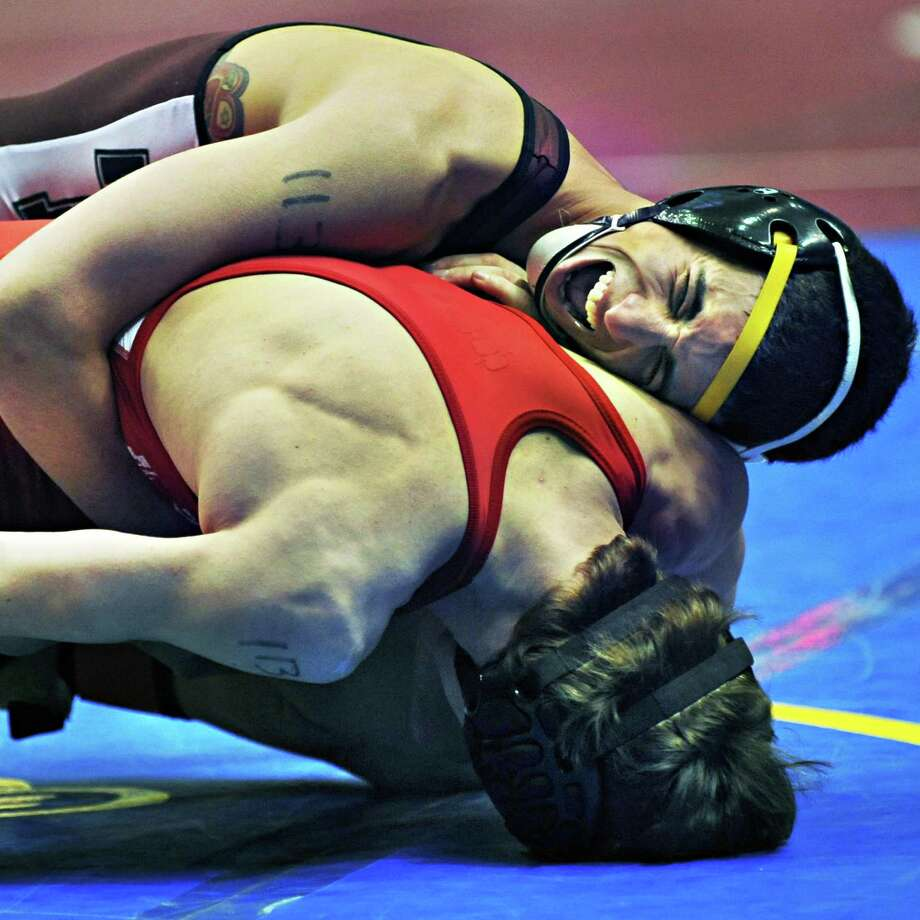 Colonie wrestler Golan Cohen, top, on his way to defeating Derek Osman of Vestal 6-0 in a first round 113 lb. match Friday morning, Feb. 28, 2014, during the State high school wrestling tournament at the Times Union Center in Albany, NY.  (John Carl D'Annibale / Times Union) Photo: John Carl D'Annibale / 00025917A