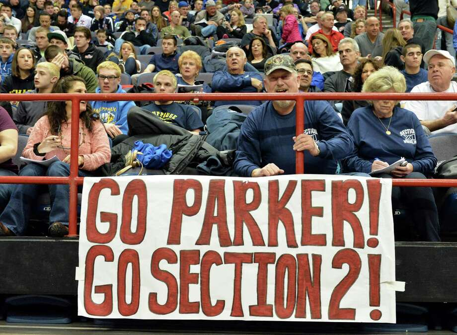 A go Parker banner for Shen wrestler Kevin Parker hangs in the stands at the Times Union Center during the State high school wrestling tournament Friday, Feb. 28, 2014, in Albany, N.Y.  (John Carl D'Annibale / Times Union) Photo: John Carl D'Annibale / 00025917A