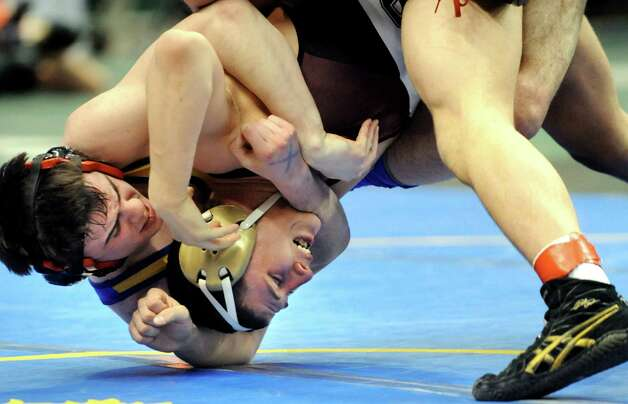 Duanesburg's Connor Lawrence, bottom, grapples with Nicholas Koelmel of Immaculate Heart Central, Watertown, in the 160-weight class in Division II durin