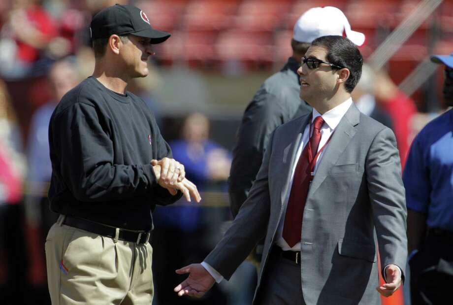 In 2013, any tension between 49ers coach Jim Harbaugh and CEO Jed York wasn't yet apparent. Photo: Carlos Avila Gonzalez / The Chronicle / ONLINE_YES